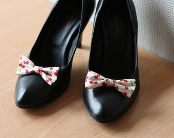 Light yellow bow shoe clips with printed cherries
