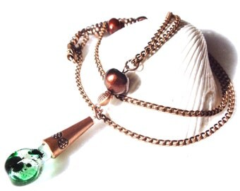 Bottle vial necklace with green bubbles of fun on copper chain with copper color beads, fresh water pearls and a Swarvorski crystal.