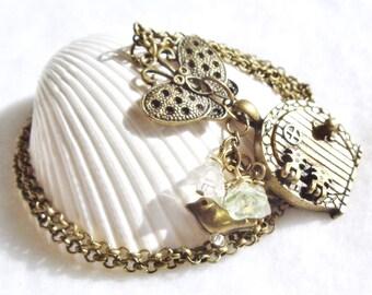 Wish door necklace in antique bronze, fairy wish door necklace with butterfly, flowers and bird