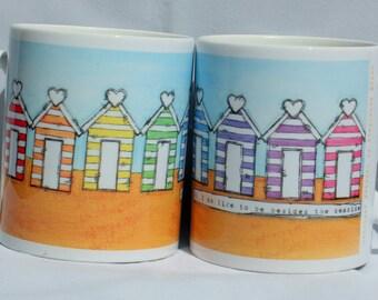 Rainbow Beach huts mug