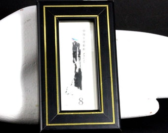 Dainty Asian Eight Cent Stamp In Attractive Black And Gold Frame