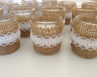 Votive candles wrapped in burlap with lace pearl, great rustic wedding candles.