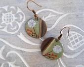 green enamel earrings with dandelion and orange berries