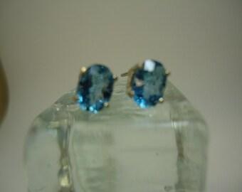 Oval Cut London Blue Topaz Earrings in Sterling Silver