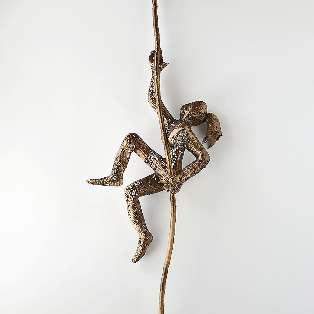Contemporary metal wall art climbing woman sculpture on rope for Wire wall art