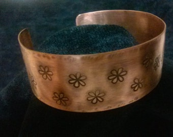copper cuff bracelet with stamped flowers