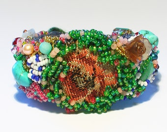 Bead embroidered cuff with rose and green and blue stones