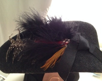 Cute vintage woman's black hat with feathers and bow