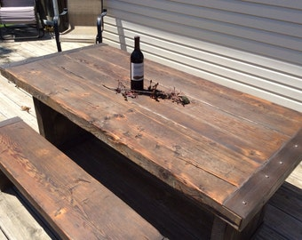 The Industrial Revolution- A Rustic Indoor/Outdoor Dining Table made from reclaimed Kansas wood with heavy duty metal/steel accents