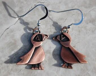 Puffin drop earrings in copper finish