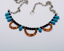 chain choker necklace with black and orange half crystals and turquoise glass drops