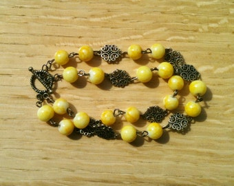 Bracelet.  Yellow beads and Antique Gold Chain.  8 inches long.