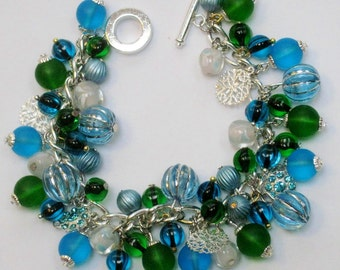 Handmade aqua blue & kelly green bead cha cha charm bracelet OOAK