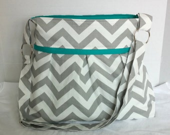 Pleated Diaper Bag large in gray chevron and teal/turquoise lining.  Adjustabe strap with elastic bottle pockets
