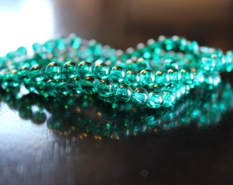 135 approx. 6 mm crackle beads, teal, hole 1 mm, round