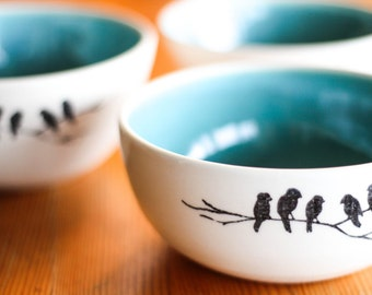 Made to Order: Ceramic cereal bowl with a turquoise interior and an image of birds on a branch.