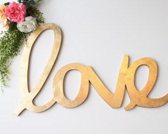 "Wedding Love Sign: oversized gold leaf ""love"" calligraphy sign"