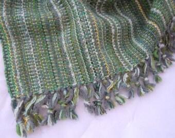 Handwoven green blanket.