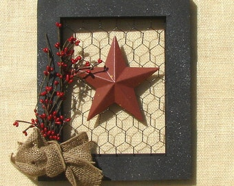 Picture  frame  with chicken wire burlap bow  and a star.