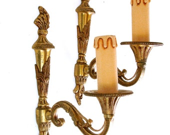 Romantic French vintage gilt bronze wall sconces. Flaming torch motif. French country shabby chic. French chateau