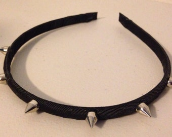Black headband with silver spikes