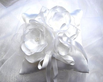 white wedding ring cushion with romantic handmade flowers in satin and organza