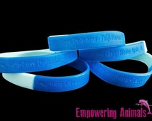 Help Cove Dolphins - Taiji Never Again Debossed Silicone Wristband, Blue-Light Blue