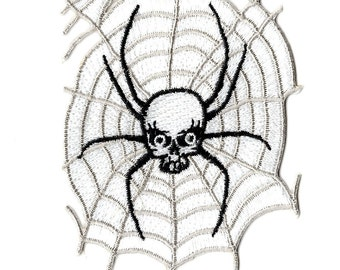 This is a skull spider web embroidered iron on  patch