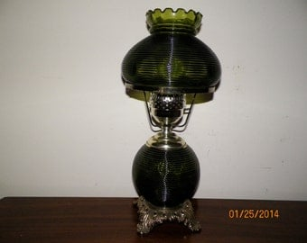 Vintgage Green Glass Lamp from the 1940/50's.  Very cute lamp and work great.