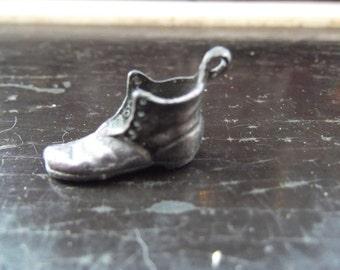 tiny white metal hobnail boot