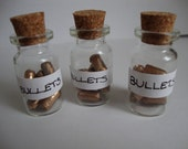 Gold (Rubber) Bullets In Glass Jar Necklace