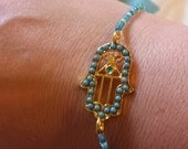 Stackable beaded bracelet with gold and turquoise hamsa