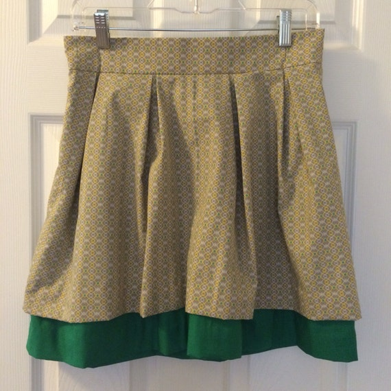 Green, Yellow, and Gray Pattern and Green Solid Double Layer Kathryn Skirt with green exposed zipper.