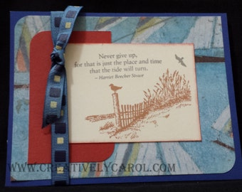 """Inspirational """"Never Give Up"""" Card with Lighthouse and Beach Setting done in Indian Corn Blue, Ruby and Honey. Card is Blank inside."""