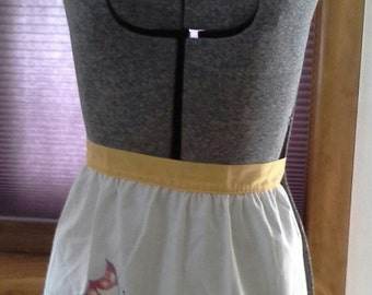 vintage 1960s white apron with yellow ties, embroidered butterfly and flower design