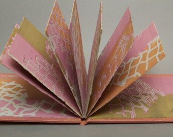 Claire, handmade artist's book with monoprints from fish nets