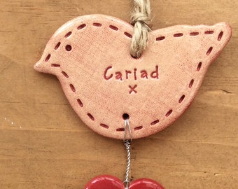 Cariad (Love in Welsh) bird with heart, hanging ceramic gift/decorative item handmade in Wales
