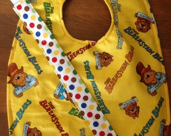 Teething bib with co-ordinating soother clip.