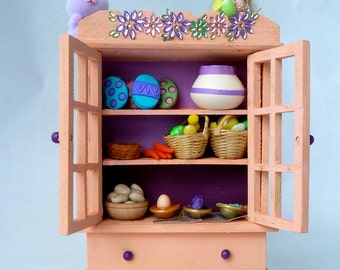 Easter cabinet where egg dying is happening and then assembling the Easter baskets for everyone.