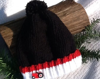 Black, white and red knit toddler hat, white and red cuff, cute red tractor button, stocking hat, very soft and warm