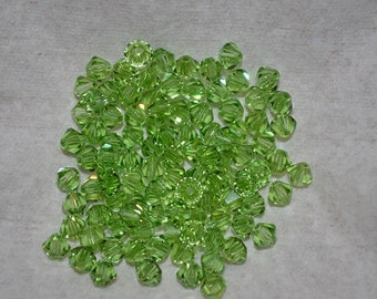 20 - 6mm Genuine Swarovski Crystal Beads - Peridot