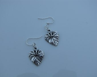 Beautiful large silver leaves hanging on silver earwires.