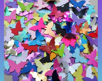 Pack of 100 + +  Butterflies. Multicoloured. Good value pack. Weddings. Decorating. Card making