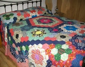 Handmade VINTAGE  hand pieced large hexagons in delightful 1960's/1970's fabrics, newly made up into a king size quilt