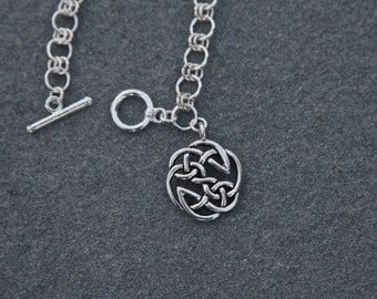 Silver Celtic Bracelet with Celtic Design Charm