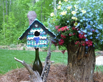 "Birdhouse & removable stand; mounted on wine bottle, vinyard scene using hand crafted plastic scrap; name ""My Heart Is In The Vineyard"""