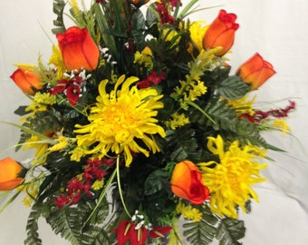 Fall Cemetery Vase in Flame Rose Buds and Yellow Mums, Red Calla Lilies, Red Bellflowers, Yellow Foam Filler, Green Silk Fern adorn this