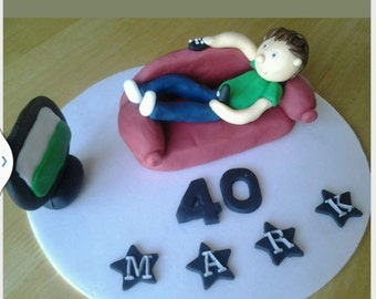 Edible man boy laid on sofa watching tv birthday cake topper