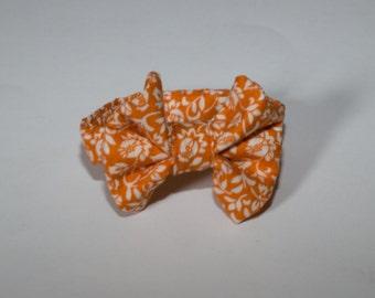 Cream floral pattern on a dark orange boy bow tie