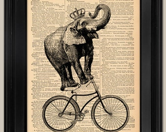 "Elephant on Bicycle Print. Vintage book page art print. Print on book page.  Fits 8""x10"" frame."